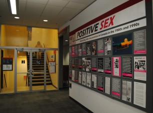 This image shows the exhibit wall and one of the stairwells in MacOdrum Library.